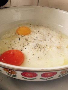 Cook eggs without breaking yolks until the bottom begins to set.  Add scant teaspoon water and put on lid.